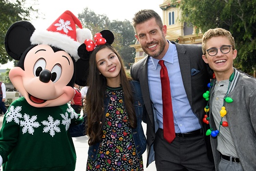 """Mickey Mouse dons his holiday finest for a photo with (l-r) actress Olivia Rodrigo from Disney Channel's """"Bizaardvark, """" sports star and commentator Jesse Palmer and actor Sean Giambrone from ABC's """"The Goldbergs"""" for a photo at Disneyland Park in Anaheim, Calif., in between breaks from taping the """"Disney Parks Magical Christmas Celebration"""" on November 13, 2017. The star-studded Christmas special, featuring performances from Walt Disney World Resort in Florida and Disneyland Resort in California, premieres December 25, 10a.m.-11a.m. EST, on The ABC Television Network. (Richard Harbaugh, photographer)"""